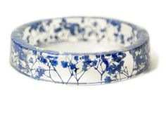 Jewelry: Blue Flower Resin Bracelet- tiny dried blue flowers embedded into crystal clear resin and shaped into stylish piece by ModernFlowerChild #eco-chic #hip-hippy #naturewrappedwrist