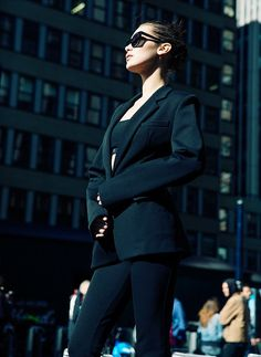 Stylish: Bella looks ever bit the New Yorker in a sporty crop top worn under a black suit...