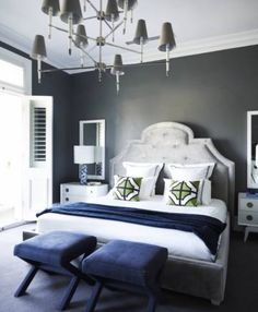 10. Drama! Even the brightest, most cheerful bedrooms need an element of dark, sexy glamour. This bedroom by Windsor Decorating and Design has them in spades: The moody wall paint, the theatrical chandelier, even an oversized gray headboard does the trick. But notice how clean lines and touches of white keep it from looking like a bordello: That balance is key. Stick with one or two pieces and you'll be golden.