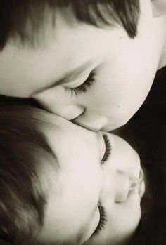 Love - This reminds me of my Grandson always kissing his Baby Sister!