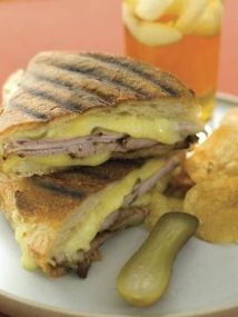 Grilled Cuban-Style Panini // Pork, pickles and Muenster cheese... Need we say more? #recipe #summer #sandwich #pork