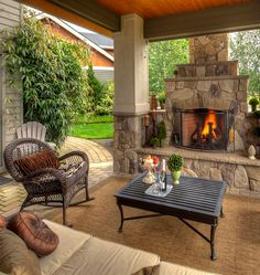 Chic wicker rocking chair in Patio Traditional with Small Outdoor Fireplace next to Fireplace Screen alongside Covered Patios With Fireplaces and Patio Fireplace Outside Living, Outdoor Living Areas, Outdoor Rooms, Outdoor Decor, Outdoor Photos, Outdoor Kitchens, Outdoor Seating, Outdoor Retreat, Rustic Outdoor