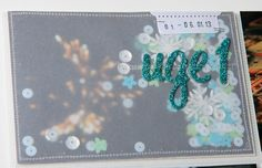 Add vellum, sequins and confetti to a title card.