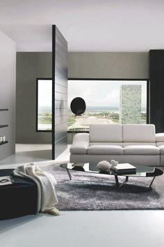 The partitioning wall is a great way to subtly break up a room