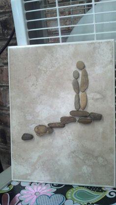 Pebble art on tile