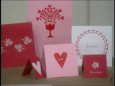 Martha Stewart teaches viewers how to use a burnisher tool to transfer patterns onto card stock to a make Valentine's Day cards.
