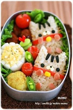 Rice ball with cute face made using seaweed punchers