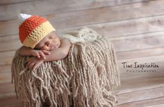 This is a candy corn hat in white, orange, and yellow. Perfect as a newborn photography prop, gift or costume for autumn, fall, harvest,