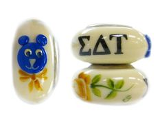 Go Greek. . . Celebrate Sisterhood with handcrafted Sorority glass beads. Meticulously hand painted and initialed by the artist, finished with a sterling silver core embossed with Fenton USA. . . a truly unique fashion accessory!  Image Shows Multiple Views of a Single Bead  Officially Licensed  6.8mm W x 14.2mm Dia  Fits Most Bracelet Styles  #glass #beads #sigma #delta #tau #bead #bear #angel #sorority #pandora #jewelry