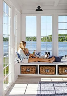 What a sunroom! A beautiful view from a Michigan cottage, plus ample storage for games and books from the 14-foot window seat's cubby baskets. More photos from this home: http://www.midwestliving.com/homes/featured-homes/house-tour-lake-house-effect?page=1
