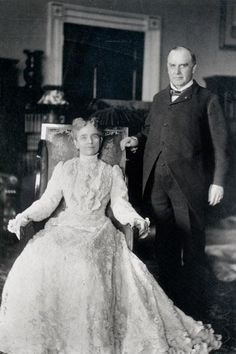 William McKinley poses for a photograph with his wife, Ida Saxton McKinley, in his office circa 1900.