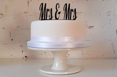 Mrs & Mrs Civil Partnership / Lesbian Wedding Cake Topper. £12.99, via Etsy.  I like this idea for a topper. The traditional people toppers are so lame! -AV