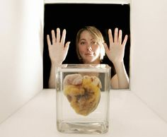 Heart transplant patient Jennifer Sutton admires her old heart at the Wellcome Collection's Heart Exhibition in London. SHAUN CURRY/AFP/Getty Images