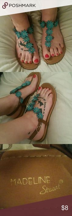 Hippie Flower Sandles Flats Really cute sandles with aqua blue daisy flowers. Adjustable ankle buckle straps.  Worn once outside when I went to get my foot tattoos and have been sitting in my closet ever since. Size 7 1/2 wide Madeline Stewart Shoes Sandals