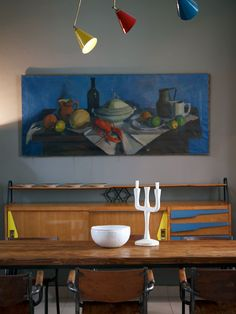 This painting,sideboard,lamp