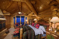 These mixed patterns are the perfect pops of color in this cozy, log cabin bedroom.