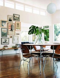 wall with upper windows and art composition leading your eyes up - light filled and beautiful
