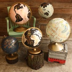 1canoe2 hand-painted globes. Available for auction starting Nov 11
