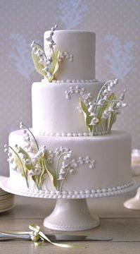 Cake with lily of the valley flowers