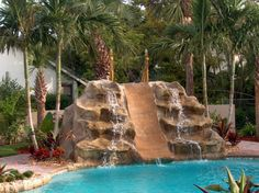 Swimming Pool Waterfall Designs waterfalls3 pool waterfalls Twisty Slide To Indoor Pool At Country Inn Suites In Nd Outdoor Spaces Recreational Areas Exterior House Views Pinterest Indoor Pools And