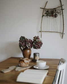 Bread, hot beverage, flowers, a book/journal... what's not to love about this scene?