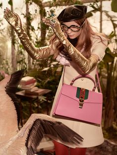 A cady crêpe wool-silk dress, black eyewear studded with clear stones, gold fingerless gloves and the top handle Sylvie bag (Polina Oganicheva).