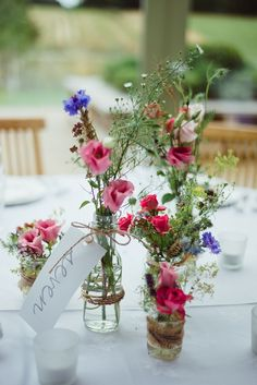 Lovely wild flowers table centre piece. http://www.emmabphotography.com/