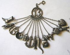 RARE GERMAN ANTIQUE, CA 1870-1880, SILVER LUCKY CHATELAINE WITH ALL 13 ORIGINAL CHARMS ATTACHED
