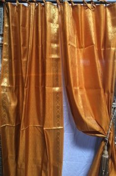 Indian Sari Fabric Exquisite sari curtains create an air of exotic elegance. Enhance the ambience with different colors and patterns that transform your house