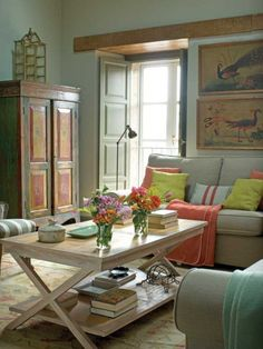 Eclectic furniture selection, pillows and throws in soft colors make for a cozy lived in statement.