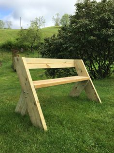 """First Leopold Bench-2x8 legs, 2x10 seat, 2x6 backrest; 48"""" wide. Super fun to make & simple to cut 30° angles with miter saw. Engraved back with Dremel tool"""