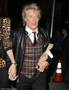 BYOB: Rod was carrying a bottle of wine as he made is way to the restaurant on Sunset Boulevard in California