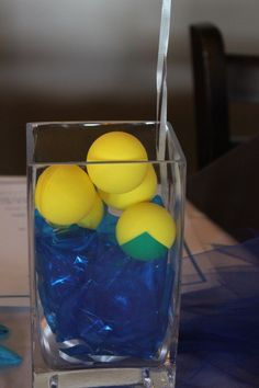 centerpieces could draw on yellow ping pong balls to make them look like water polo balls