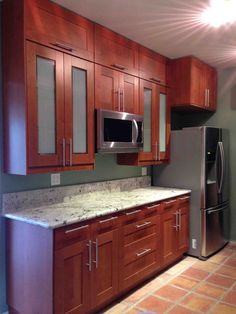 Beautiful Grimslov Medium Brown IKEA kitchen cabinets accented with a white granite countertop... This project was in Hollywood, CA...