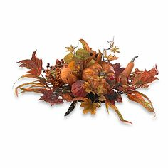 Leaves in the most glorious shades of fall, festive gourds, berries and pumpkins make this stunning centerpiece. It's the perfect annual guest at all of your holiday dinners.
