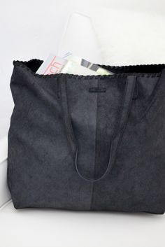 Travel in style with a TOMS Distressed Leather Cosmopolitan Tote