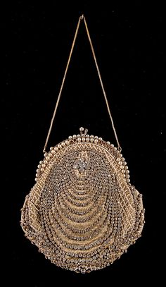 Bag, Evening  Date: ca. 1915 Culture: American Medium: Silk, rhinestones, pearl beads, metal Credit Line: Brooklyn Museum Costume Collection at The Metropolitan Museum of Art, Gift of the Brooklyn Museum, 2009; Gift of Grace Potter Leeds, 1957