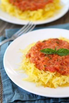 Baked Spaghetti Squash with Creamy Roasted Red Pepper Sauce on twopeasandtheirpod.com My favorite spaghetti squash recipe!