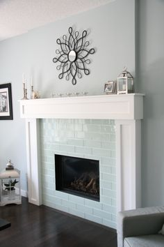 Smoke Grey Glass tile on fireplace in unusual size.