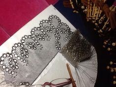 point ground lace in process.