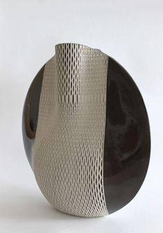 Hélène Morbu's ceramic vases of her woven patterned 'Quetzal' Collection.