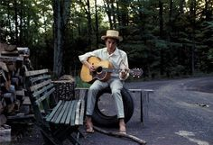 For a few weeks I've admired pictures from photographer Elliott Landry, taken of Bob Dylan outside his Byrdcliff home in Woodstock, New York. Dylan's casual yet polished southern style, with his cobalt blue pants (http://calvinklein.com/product/index.jsp?productId=12378703) and troubadourial hat, really endear Landry's photos. Read more at http://standardequipment.co