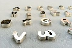 Your Initial Sterling Silver Pendant with by XekebCustomSilver, $75.00   Look at all these darling little letters!!!!