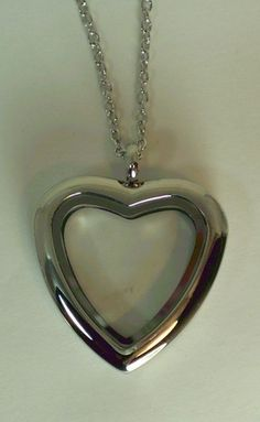 "Silver Stainless Steel Heart Necklace with Free Necklace $20 plus tax and shipping approx 1 1/4 x 1 1/4"" please send me a message of what you want to order. Then I will message you the total cost and give you the paypal info so you can pay for your items so I can order it."