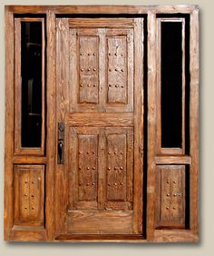 Front Entry with Sidelites Reproduction door constructed using reclaimed Douglas fir. Features bronze thumb latch entry set with teardrop key flap & clavos. 7524A Grissom