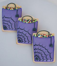 Make Me Cake Me on Etsy...i like your stuff.   Purple Halloween Trick-or-Treat Bag Sugar Cookies with Royal Icing Spiders