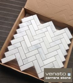"Herringbone, made from Carrara marble.  Not your standard 1x2"" Herringbone either.  This is a 1x3"" format.  The slightly longer pieces somehow give it a more elegant look.  $11.45 a Square Foot.  #Carraraherringbone"