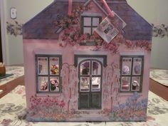 """Nov. 30, 2014 - The gift bag looks like the exterior of a house and also has a design on the back """"wall"""".  The set came with three bristol board/foam board pieces for the floor and side walls which would support the bag and help it keep its shape as well as adding sturdiness."""