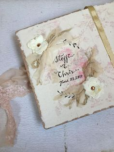 Beautiful handmade blush pink wedding guest book with a lovely shabby vintage and romantic fairytale look.  It is hand bound with a hardback cover which I make with a textured effect and can be painted in any colour.  MADE TO ORDER  VARIATIONS AVAILABLE: Hand Printed Pages with torn edges OR Blank unlined pages with torn edges.  S I Z E 8.5x6 [22cm x 15cm] approximately USES •Photo album •Guest book [up to 200 guests] •Photo booth album •Bridal shower •Baby shower •Baby album   D E T A I L S…