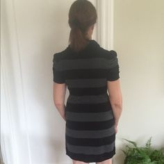 Very sophisticated striped dress. Very sophisticated gray stripped dress.  Light weight. It is so comfortable and stretches.  It fits me at size 6-8. Dresses Mini
